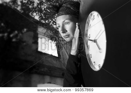 Girl On The Ruins Of The House With A Huge Clock In His Hands.