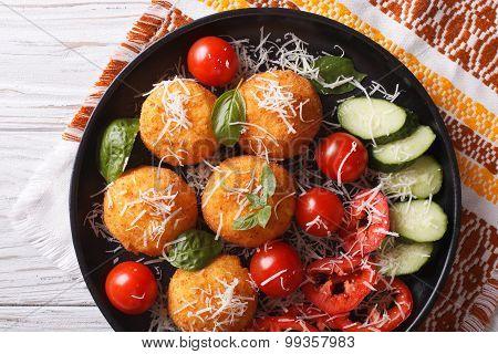 Italian Arancini Rice Balls With Cheese Close-up. Horizontal Top View