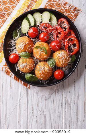 Italian Arancini Rice Balls With Cheese. Vertical Top View