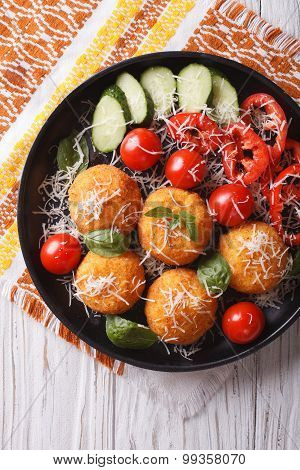 Italian Arancini Rice Balls With Cheese Close-up. Vertical Top View