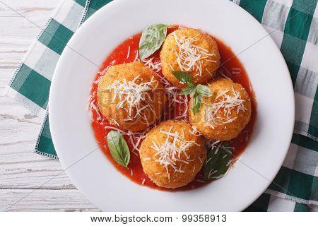 Fried Arancini Rice Balls With Tomato Sauce Closeup. Horizontal Top View
