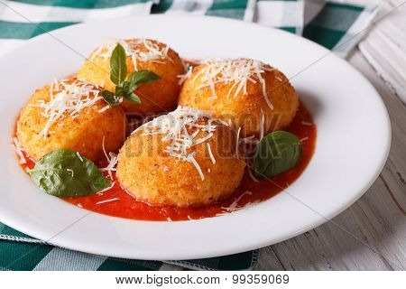 Delicious Fried Arancini Rice Balls In Tomato Sauce Close-up. Horizontal