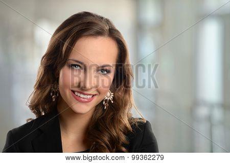 Portrait of beautiful businesswoman smiling inside office building