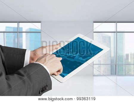 Close Up Of Hands With Tablet And Forex Screen. Panoramic Office In Financial Business Centre.