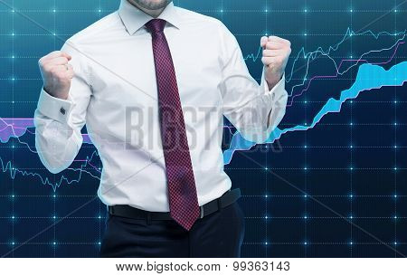 Closeup Of Successful Portfolio Manager In White Shirt With Pumped Fists. A Concept Of The Celebrati