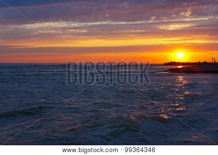Amazing sea sunset on stony seashore