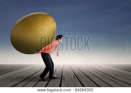 Businessman with Golden Egg