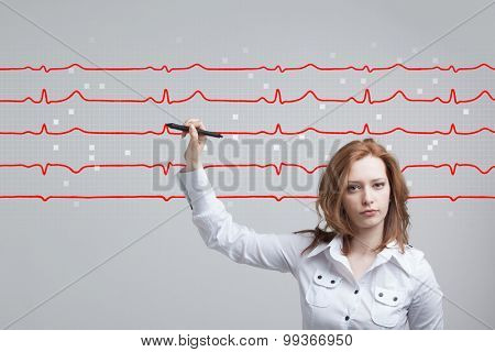 young doctor woman drawing cardiogram in air