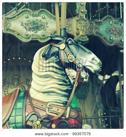 Horse in a carousel at the fair.  Cross processed to look like an aged and instant photo with texture.