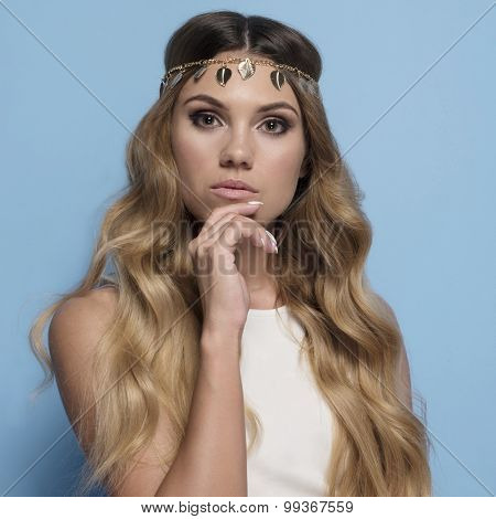 portrait of woman with retro style hair and white dress
