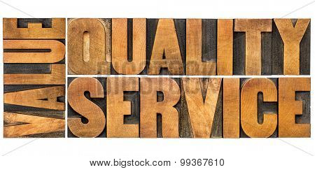 value, quality, service - business mantra or motto concept - isolated words in vintage letterpress wood type printing blocks