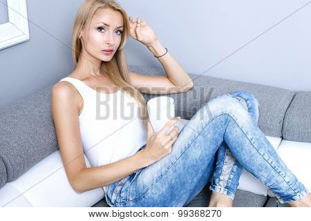 Blonde Young Woman Relaxing At Home.