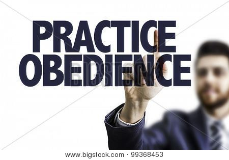 Business man pointing the text: Practice Obedience