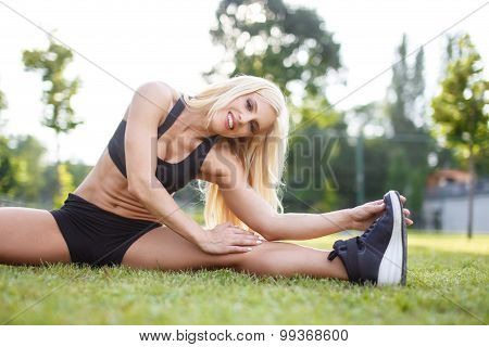 Woman Doing Stretching Exercises Outdoor