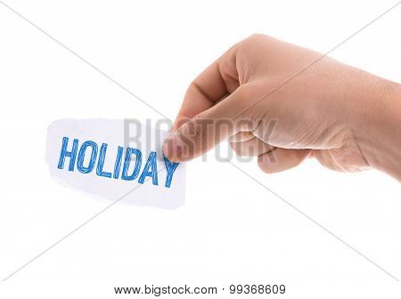 Piece of paper with the word Holiday isolated on white background