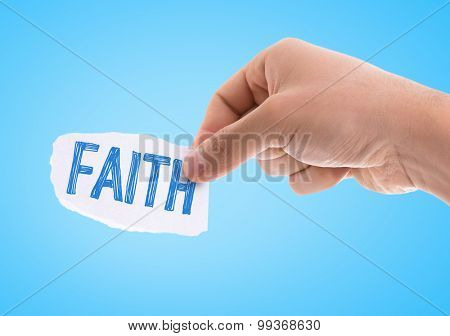 Piece of paper with the word Faith with blue background