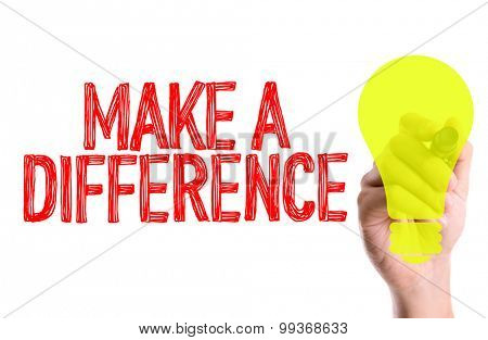 Hand with marker writing the word Make a Difference