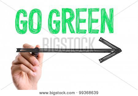 Hand with marker writing the word Go Green