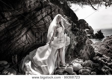 Sensual Woman In Wedding Dress Posing Outdoor.
