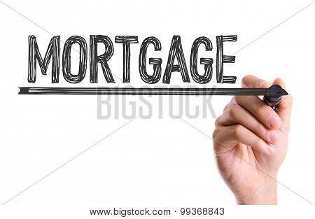 Hand with marker writing the word Mortgage
