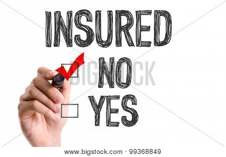 Hand with marker writing the word Insured - No