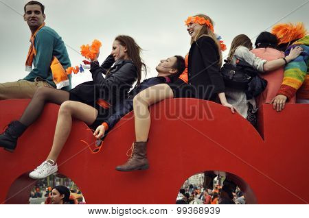 Young People On The Top Of The Iamsterdam Sign In Amsterdam.