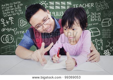 Male Teacher Teach His Student To Calculate