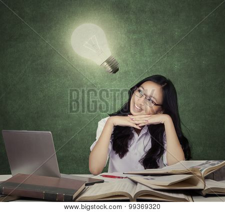 Smart Teenage Student With Lightbulb