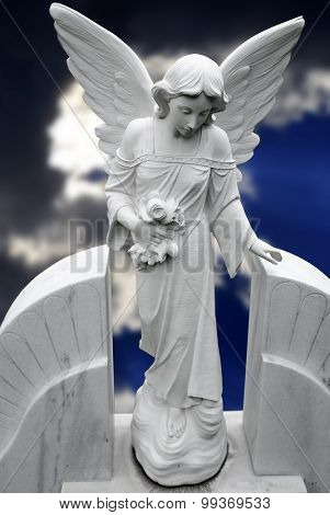 Antique marble statue of a winged angel with stretched out hand