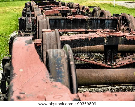 Row of Old Train Chassis and Wheels