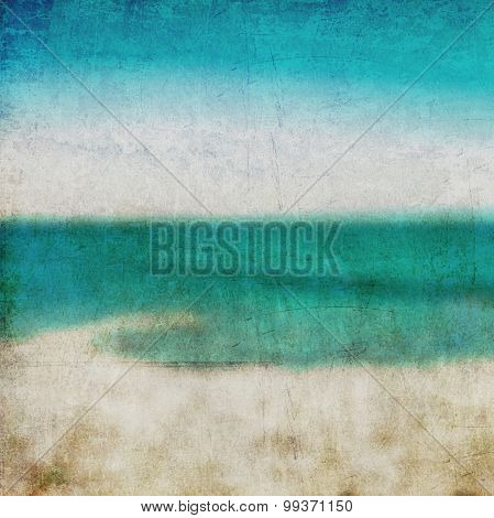 Abstract background. Golden sand beach with blue ocean and cloudscape