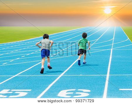 Boy Running On Racetrack