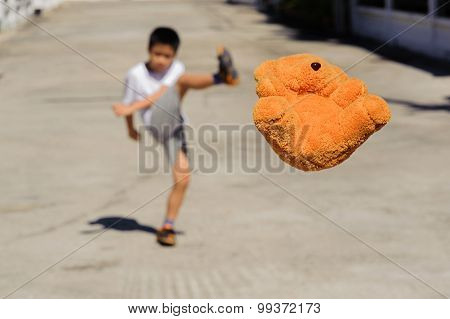 Boy Kick The Bear