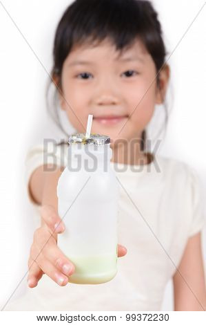 Thin Focus On Milk Bottle From Young Girl