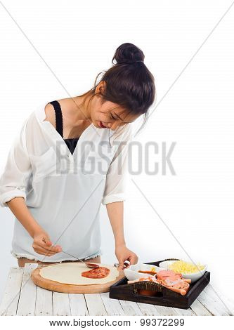 Woman Prepareing Pizza
