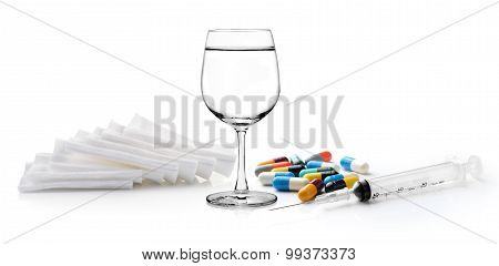 Glass Of Water  Syringe Pill And Cotton Bandage On White Background