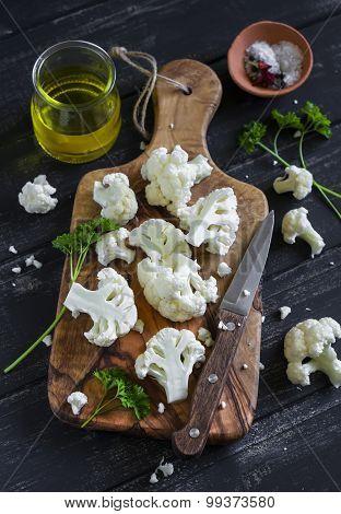 fresh cut cauliflower on a olive Board