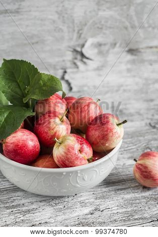 Fresh Red Apples In A White Bowl On A Light Wooden Surface