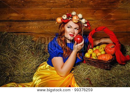 Girl Is Holding A Pomegranate Fruit.