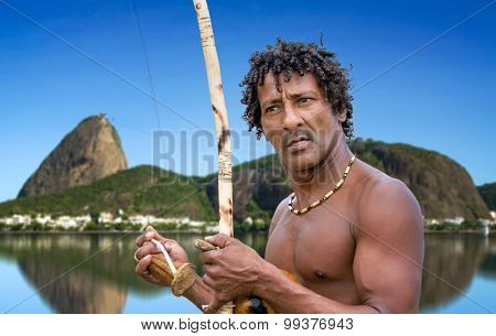 Brazilian performing Capoeira with Berimbau Instrument in Rio de Janeiro
