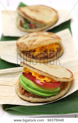 arepas, corn bread sandwich, venezuelan colombian food