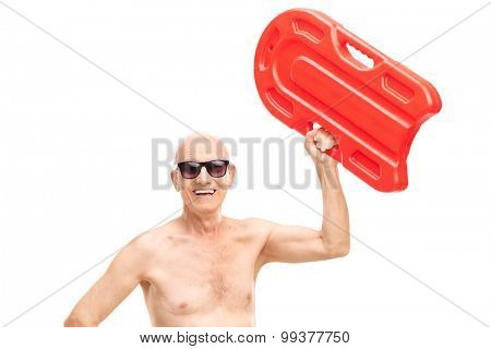 Shirtless senior holding a swimming float up in the air and looking at the camera isolated on white background