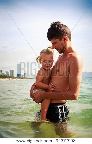 Father Presses To Breast Little Daughter In Sea Water