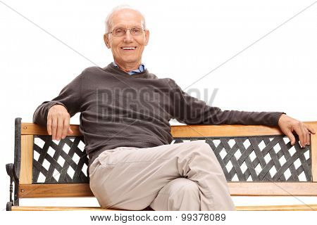 Serene senior sitting on a wooden bench and looking at the camera isolated on white background