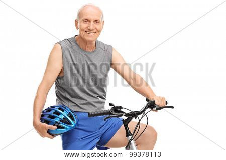 Senior biker holding a blue helmet seated on his bike and looking at the camera isolated on white background