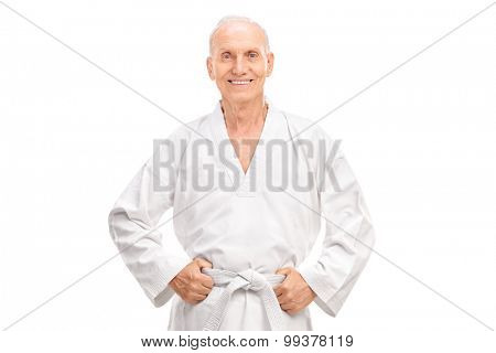 Joyful senior in a white kimono with a white belt looking at the camera and smiling isolated on white background