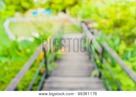 Blur Image Of Long Empty Corridor With Open Space To The Green Garden