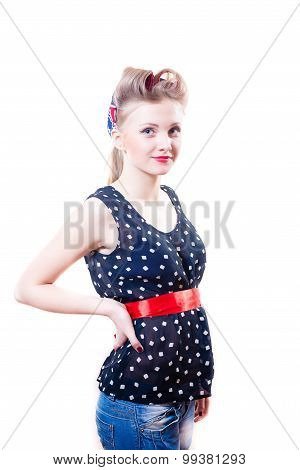 Stylish picture of young blond girl with hair curlers in polka dots top