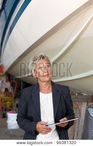 Businesswoman Giving An Opinion On A Shipyard