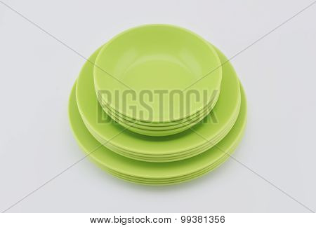 Stack Of Green Plastic Plate And Dish Isolated On White